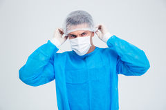 Portrait of a male surgeon. Standing isolated on a white backgorund and looking at camera Royalty Free Stock Images