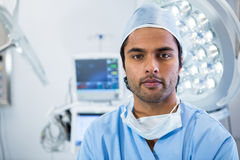 Portrait of male surgeon standing in operation theater. Of hospital Stock Images