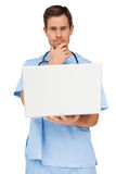 Portrait of a male surgeon using laptop. Over white background Stock Images