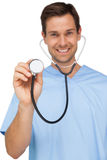 Portrait of a male surgeon using stethoscope. Over white background Stock Photos