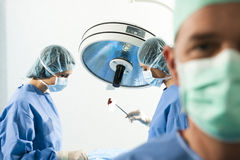 Portrait of a Male Surgeon At Work Stock Images