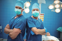 Portrait of male surgeons standing in operation theater Royalty Free Stock Images