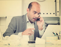 Portrait of male  talking on the phone. Portrait of male working in office and talking on the phone Stock Image
