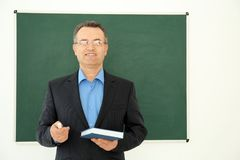 Portrait of male teacher. In classroom Royalty Free Stock Image