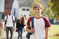 Portrait Of Male Teenage Student Walking Around College Campus Stock Image