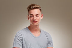 Portrait of male teenager looking down to the left corner Royalty Free Stock Photos