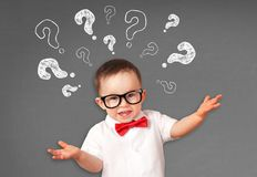 Portrait of male toddler with questions. On blackboard stock photos