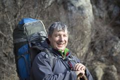 Portrait of a male tourist with a large backpack on the backgrou. Nd of rocks Stock Photo