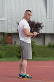 Portrait Of A Male Trainer Holding Clipboard Outdoor Royalty Free Stock Image