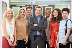 Portrait Of Male Tutor In Class With Students. Smiling And Laughing Stock Photos