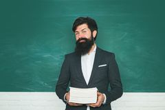 Portrait of male University Student indoors. Student and tutoring education concept. Learning and education concept. Exam in college. Bearded professor at royalty free stock image