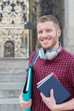 Portrait Of Male University Student Standing Outside Building Stock Photography