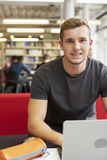 Portrait Of Male University Student Working In Library Stock Photo