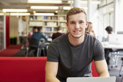 Portrait Of Male University Student Working In Library Royalty Free Stock Photos