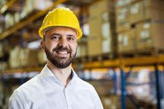 Portrait of a male warehouse worker or supervisor. Portrait of a male warehouse worker or a supervisor Stock Photos