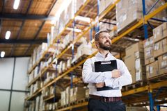 Portrait of a male warehouse worker or supervisor. Portrait of a male warehouse worker or a supervisor holding notes Stock Image
