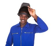 Portrait of male welder. Portrait Of Happy Male Welder Standing Over White Background Stock Photography