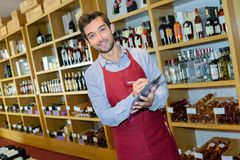 Portrait male wine merchant with clipboard Royalty Free Stock Photos