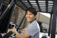 Portrait Of A Male Worker Driving Forktruck Royalty Free Stock Image