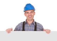 Portrait Of Male Worker With Placard. Happy Male Worker With Placard Over White Background Stock Photo