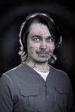 Portrait of a male zombie with cracked skin Royalty Free Stock Images
