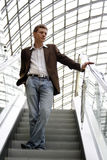 Portrait of the man. Portrait of the modern young man on the escalator Stock Image