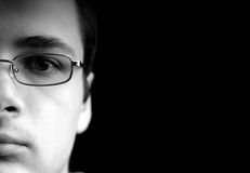 Portrait of a man. Portrait of a young man on black background Stock Photos