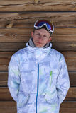 Portrait of a man against a background of a wooden wall. In ski clothes Stock Image