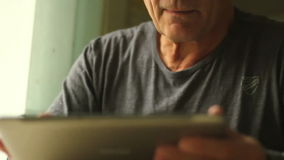 Portrait of a man at the age with Tablet PC stock video footage
