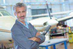 Portrait man in aircraft hangar Stock Photo