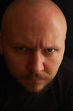 Portrait of man with angry look. On black background Royalty Free Stock Image