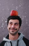Portrait of a  man and apple Stock Photography