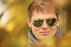 Young men walking autumn park fanny sunny day. Portrait man in autumn park fanny sunny day royalty free stock photography