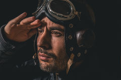 Portrait of a man with aviator helmet and goggles royalty free stock photography