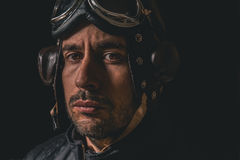 Portrait of a man with aviator helmet and goggles looking straight on royalty free stock photos
