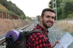 A portrait of a man with backpack arriving at the train station isolated about to start El Camino de Santiago in Spain or France Royalty Free Stock Photo