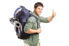 Portrait of a man with backpack giving thumb up Stock Photo
