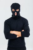 Portrait of man in balaclava standing with arms crossed Stock Photography