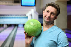 Portrait of man with ball for bowling. In bowling club Stock Photography