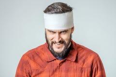 Portrait of man bandaged up Stock Image