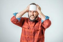 Portrait of man bandaged up Royalty Free Stock Photography