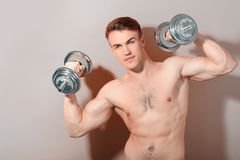 Portrait of man with barbell Royalty Free Stock Photography
