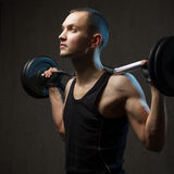 Portrait of man with barbell Stock Images