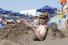 Portrait of man on beach Stock Photos