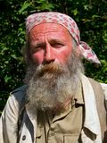 Portrait of Man with Beard 10. A portrait of the old weather-burned smiling man with big grey beard. Sunny day, summer. Russian Far East, Primorye Stock Photo