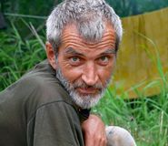 Portrait of Man with Beard 11. A portrait of the weather-burned man with grey beard and intent look.  Russian Far East, Primorye Royalty Free Stock Images