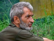 Portrait of Man with Beard 15. A portrait of the weather-burned man with grey beard and intent look. Profile. Russian Far East, Primorye Royalty Free Stock Photo