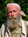 Portrait of Man with Beard 17. A portrait of the old weather-burned smiling man with big grey beard. Sunny day, summer. Russian Far East, Primorye Stock Photography