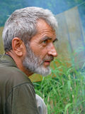 Portrait of Man with Beard 24. A portrait of the weather-burned man with grey beard and intent look. Profile. Russian Far East, Primorye stock photos