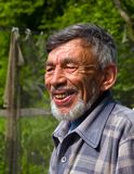 Portrait of Man with Beard 8. A portrait of the old weather-burned smiling man with grey beard. Sunny day, summer. Russian Far East, Primorye royalty free stock photography